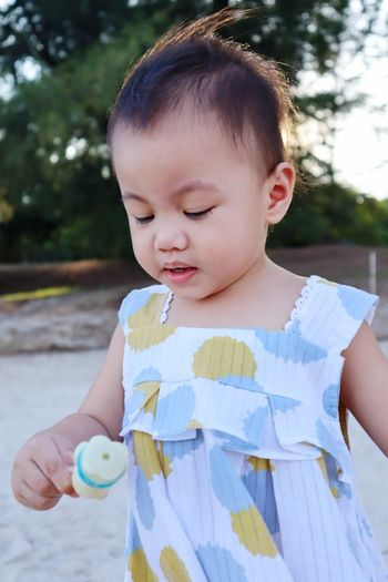 Close-up of girl holding toy