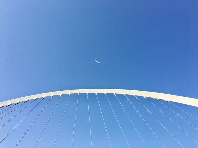 Fly high. Chadventurestories Blue Clear Sky Built Structure Architecture Day Outdoors Sky Bridge Airplane Yolo Freedom Summer Wander EyeEm Selects EyeEmNewHere Fly High Up Away Arc Footbridge Pattern Art The Architect - 2018 EyeEm Awards