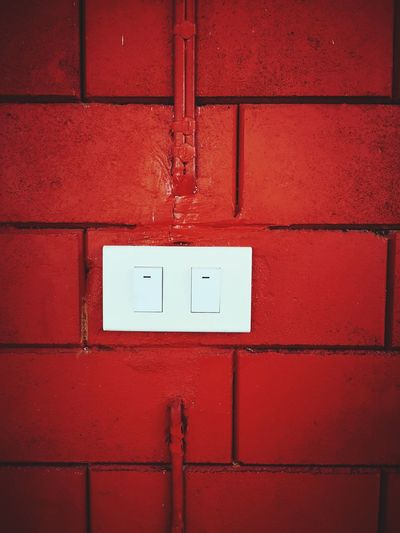 Turn on switch at the red brick wall, texture background