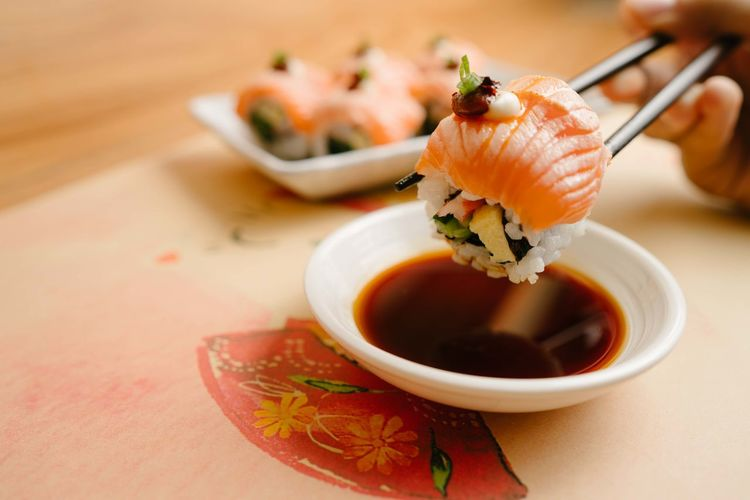 Sushi Food And Drink Seafood Food Asian Food Japanese Food Sushi Freshness Rice Healthy Eating Wellbeing Close-up Sauce Ready-to-eat Indoors  Plate Condiment Chopsticks Salmon - Seafood Focus On Foreground No People Soy Sauce Sashimi  Savory Sauce Crockery