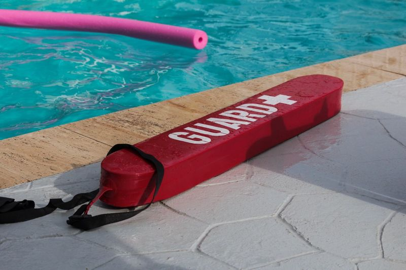 Rescue Lifesaver Lifeguard  Swimming Pool Pool Water Red Day Nature High Angle View Poolside Sport Guidance Safety Outdoors Communication