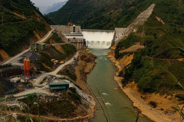 mountains in vietnam Vietnam Vietnamphotography Vietnam Mountains Đồng Văn Built Structure Architecture Transportation High Angle View Water Road Mountain Building Exterior Day Hydroelectric Power Nature Plant No People Dam Tree Motor Vehicle Fuel And Power Generation River Car Outdoors