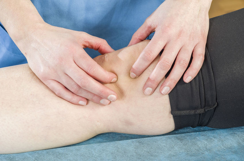 Physiotherapist, chiropractor doing a patellar mobilization, Knee pain. Spraining torn ligaments. Back Doctor  Exercising Hands Medicine Pain Woman Chiropractor Clinic Female Hand Health Healthcare And Medicine Knee Massage Muscle Osteopathy Patient Physiotherapy Professional Stretching Terapy Treatment