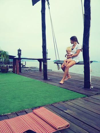 Woman with small baby at the swing with beautiful seaview Holding Hands Mobilephotography Girl Baby Child Travel ASIA Lanta Pier Morning Morning View Seaview Seascape Atmospheric An Eye For Travel Full Length Adult Swing People Women Outdoors Young Women Beautiful People