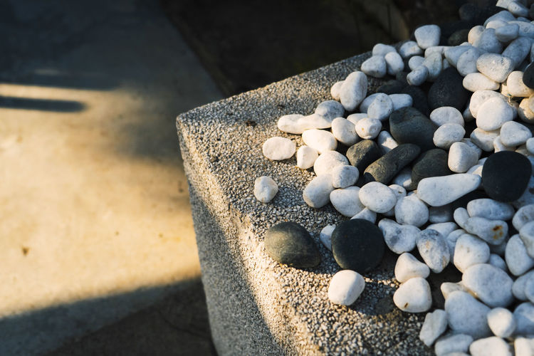 High angle view of pebble stones on land