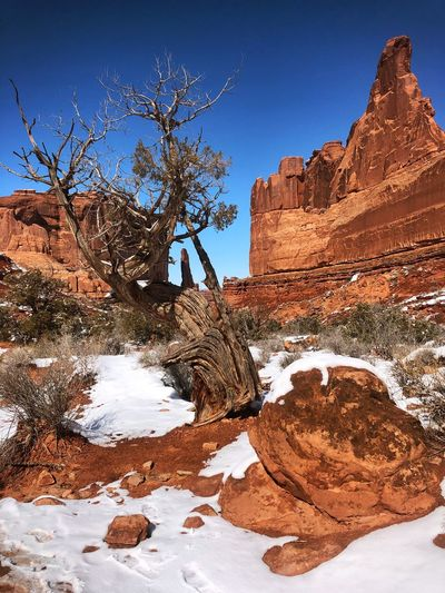 Rock formations on snow covered landscape