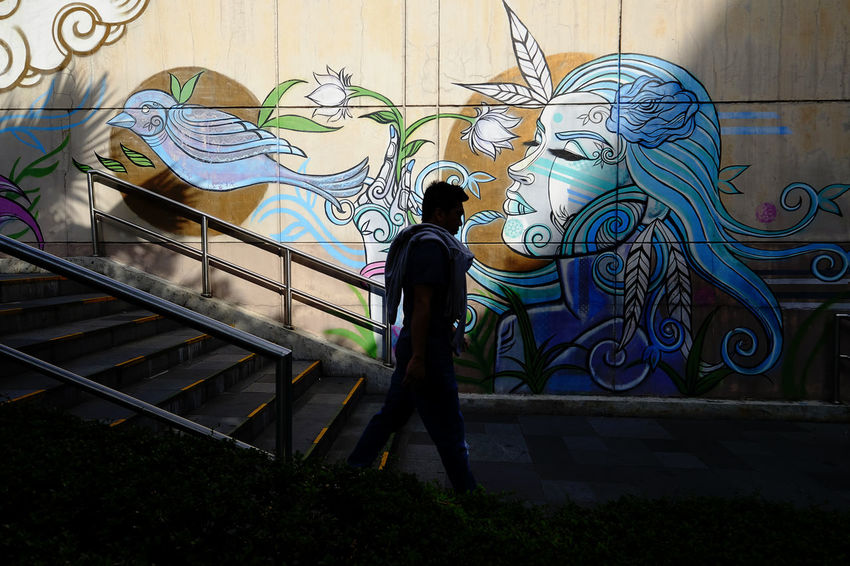 Colors Shadows & Light Silhouette Architecture Art And Craft Building Exterior Built Structure Day Full Length Graffiti Leisure Activity Lifestyles Men One Person Outdoors People Real People Standing Walking