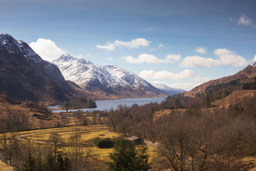 Scotland Beauty In Nature Cloud - Sky Day Environment Glenfinnan Idyllic Land Landscape Mountain Mountain Peak Mountain Range Nature No People Non-urban Scene Outdoors Plant Scenics - Nature Sky Snow Snowcapped Mountain Tranquil Scene Tree Water Wilderness