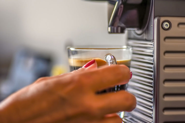 woman using a cappuccino machine in luxury hotel in Montreal Holding Hands Morning Ritual Routine Adult Body Part Cappuccino Cappuccino Break Close-up Domestic Room Finger Focus On Foreground Food And Drink Glass Mug Hand Holding Human Body Part Human Finger Human Hand Indoors  Kitchen Lifestyles One Person Personal Perspective Real People