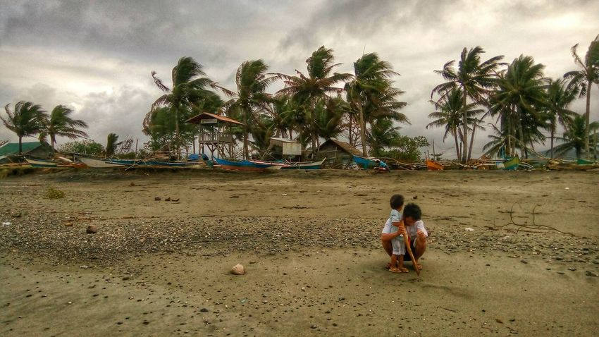 Windy afternoon on a beach Philippines Aklan Afternoon father Son Eyeem Philippines Mobile Photography