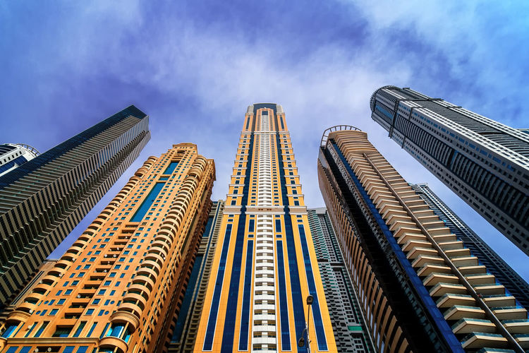 Majestic colorful dubai marina skyscrapers. Detail of world tallest residential buildings. Dubai marina, United Arab Emirates. Dubai Dubai Marina United Arab Emirates Apartment Architecture Building Building Exterior Built Structure City Cloud - Sky Day Detail Development Financial District  Low Angle View Modern Nature No People Office Office Building Exterior Outdoors Sky Skyscraper Tall - High Tower