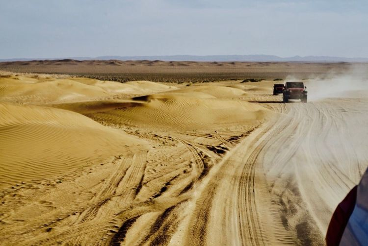 FlightToJaran Desert Sand Transportation Sand Dune Arid Climate Landscape Off-road Vehicle Day Road Land Vehicle Outdoors Tire Track Physical Geography Travel Destinations Scenics Nature Sky No People Jeep Connected By Travel