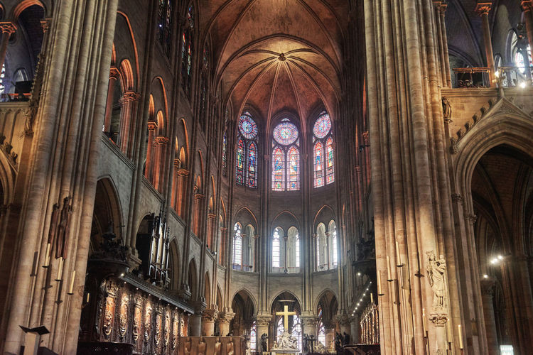 Place Of Worship Architecture Religion Belief Spirituality Built Structure Building Indoors  Arch Travel Destinations Ceiling Glass Window Architectural Column Illuminated Stained Glass Gothic Style Arched Notre Dame De Paris Notre-Dame Mosaic Apse Crucifix Church Church Architecture