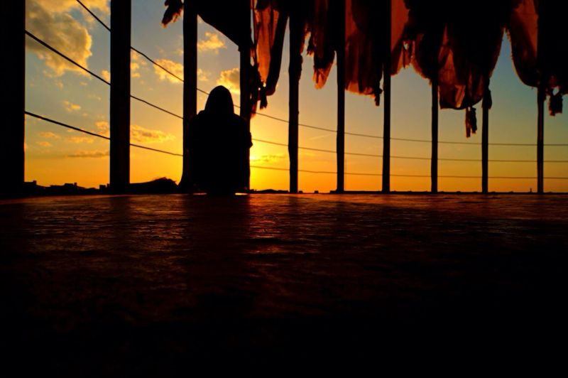 Silhouette Woman Overlooking Scenic Sky At Sunset