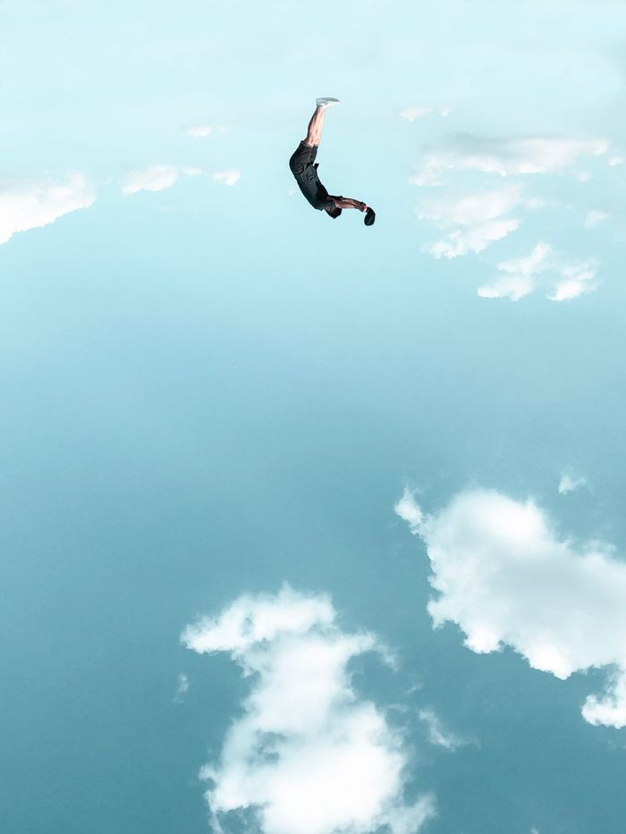 High angle view of man falling over sea