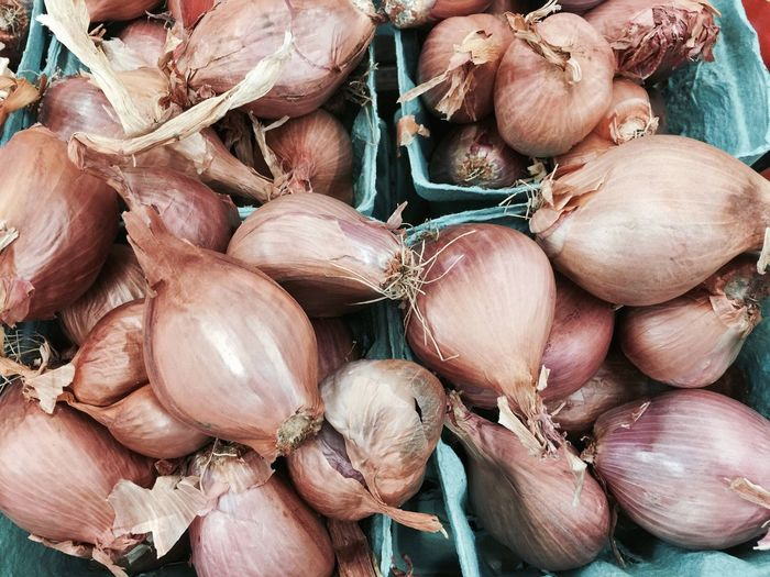 High angle view of fresh onions at market stall