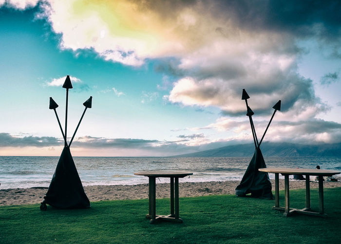 Set up for a beach gathering on Maui Beach Photography Hawaii Life Party Time Beach Beauty In Nature Cloud - Sky Day Grass Hawaii Vacations Horizon Over Water Maui Hawaii Maui Life Mauiphotography Nature No People Outdoors Scenics Sea Sky Sunset #sun #clouds #skylovers #sky #nature #beautifulinnature #naturalbeauty #photography #landscape Tables Tiki Torch Tranquil Scene Tranquility Water