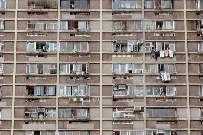 detail of condominium in hongkong, old film look effect Air Conditioner Downtown Exterior Hanging HongKong Living Residential  Abstract Apartment Architecture Background Balcony Building City Compressor Condominium Development Dry Clothes Flat House Pattern Repetition Texture Wallpaper Window
