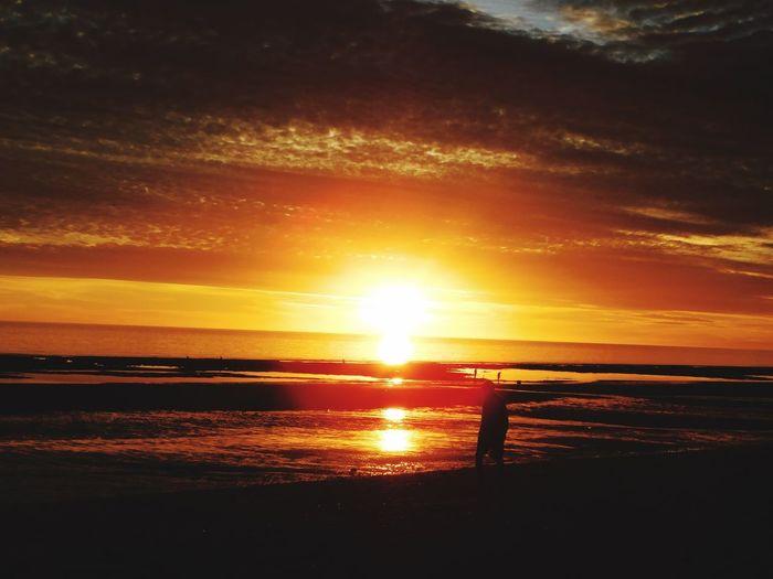 New Year's Eve sunset Orange Color Horizon Over Water Outdoors Leisure Activity Sunlight Beach Sun