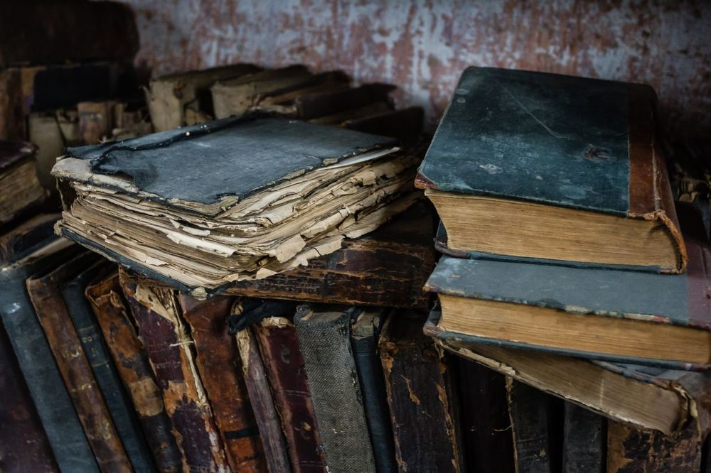 Books Bookshelf Jewish Place Of Worship Spirituality Abandoned Close-up Damaged History Indoors  Jewish Culture No People Old Books Religious Place Stack Synagogue Wood - Material