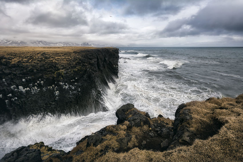 Landscape in Iceland Beauty In Nature Cloud Cloud - Sky Cloudy Day Horizon Over Water Idyllic Motion Nature No People Outdoors Power In Nature Remote Rock Rock - Object Rock Formation Scenics Sea Shore Sky Splashing Tranquil Scene Tranquility Water Wave