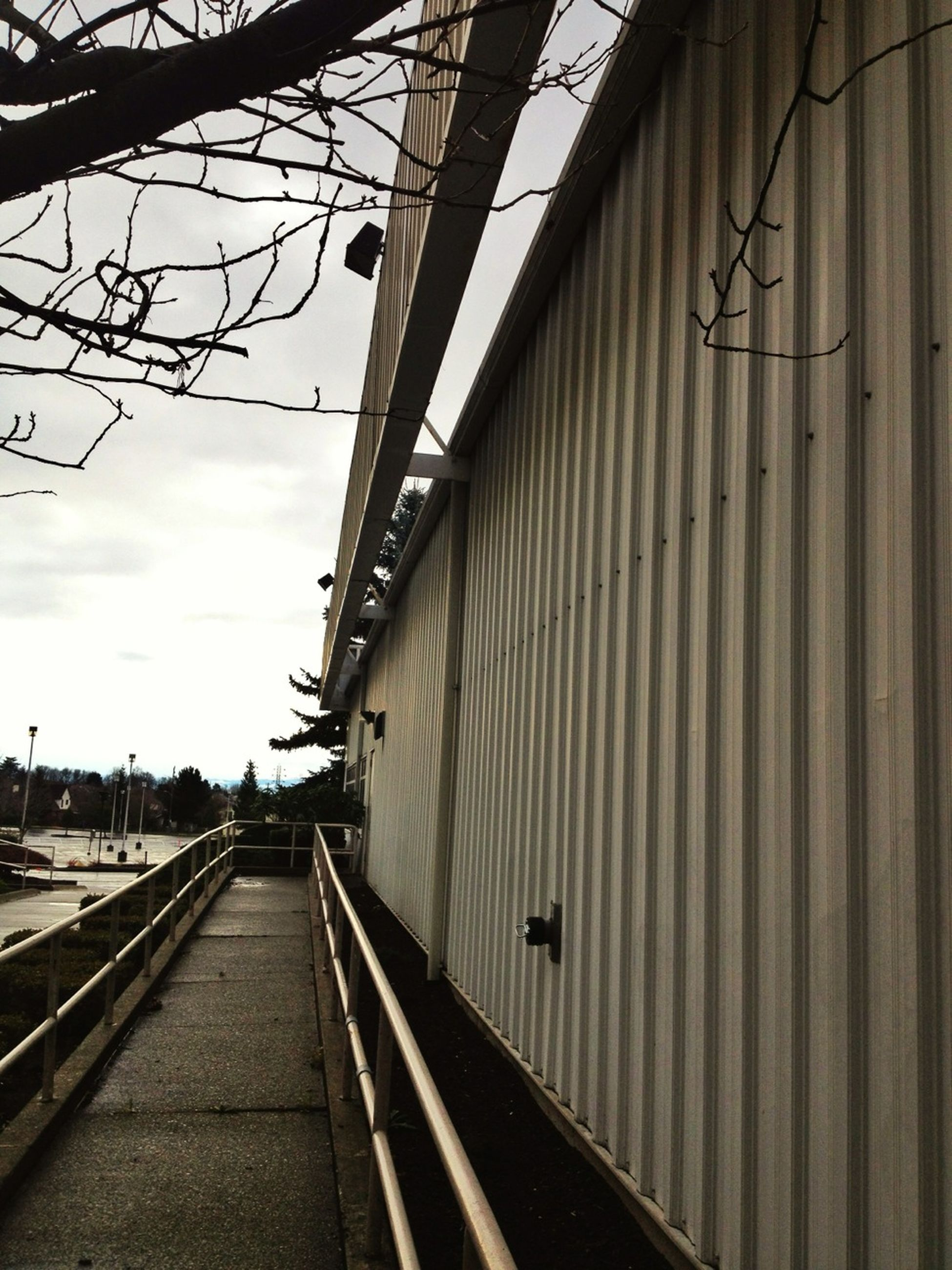architecture, built structure, the way forward, railroad track, diminishing perspective, transportation, building exterior, rail transportation, vanishing point, sky, railing, public transportation, long, connection, railroad station, railroad station platform, city, day, narrow, railway track