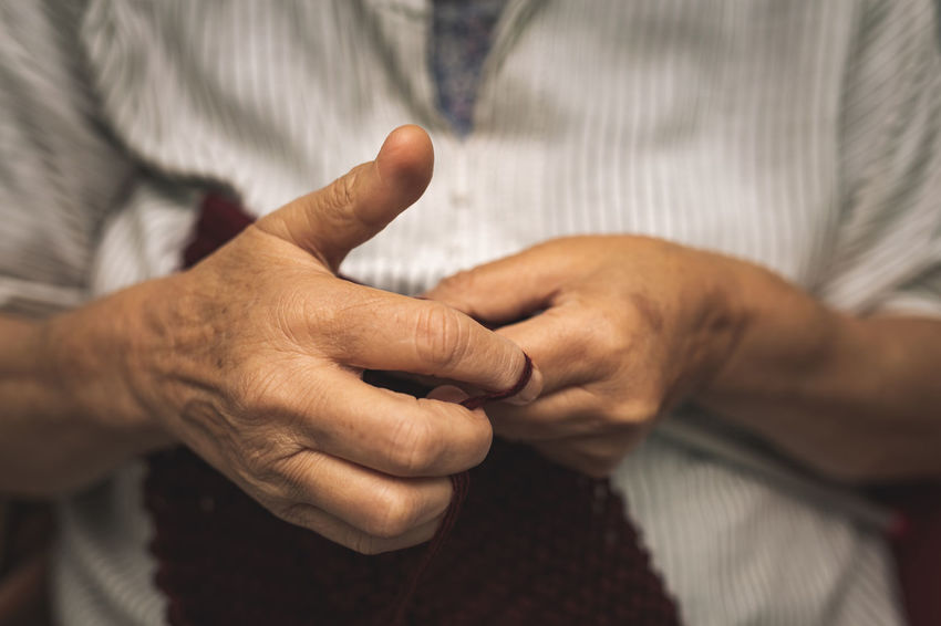 close up of old woman's hands knitting Hand Human Hand Human Body Part Finger Midsection Real People Body Part Adult Human Finger Men People Two People Selective Focus Togetherness Indoors  Close-up Focus On Foreground Front View Women Care Old Woman Cosy