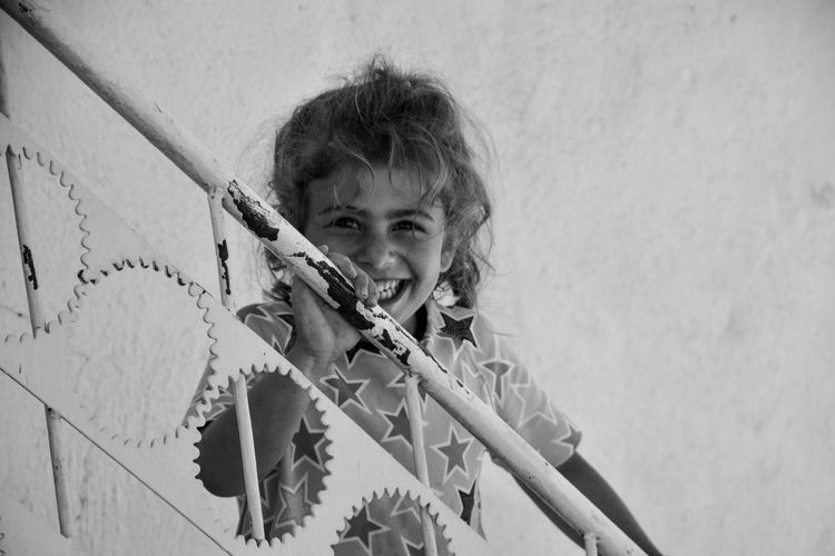 Portrait Looking Down One Person People Outdoors Day Black And White Black & White Childhood Traveling Nikonphotography VillagePeople Village Child Childhood Smile Girl