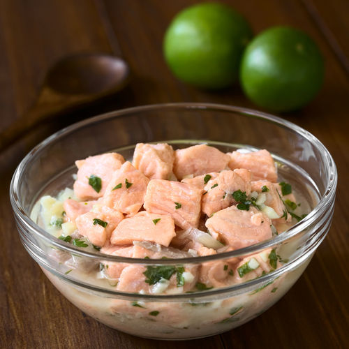 Chilean salmon ceviche prepared with onion, garlic, fresh coriander, salt and lemon juice, photographed with natural light (Selective Focus, Focus in the middle of the ceviche) Breakfast Chile Chilean  Garlic Homemade Meal Raw Seafood Snack Appetizer Cebiche Ceviche Chilean Food Cilantro Coriander Fish Food Food And Drink Fresh Lemon Lemon Juice Onion Raw Food Salmon Sour