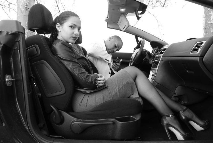 Portrait Of Beautiful Woman Sitting By Man In Car
