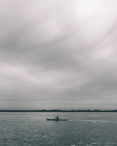 Alone on the water Alone Black And White Black And White Photography Blackandwhite Canon Cloud - Sky Day Horizon Over Water Kajak Lonely Monochrome Monochrome Photography Nature Outdoors Relaxing Sigma 35mm Art Sky Sport Storm Cloud Water