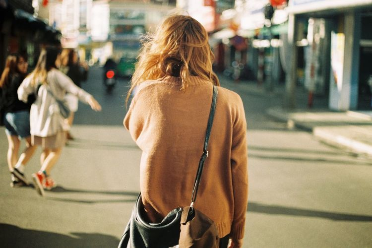 Rear view of woman walking in the city