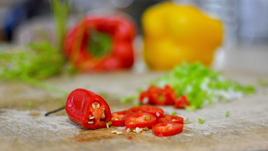 Chili Pepper Chopped Close-up Food Food And Drink Freshness Fruit Healthy Eating Indoors  Ingredient No People Pepper Raw Food Red Red Chili Pepper Selective Focus Spice Still Life Tomato Vegetable Wellbeing