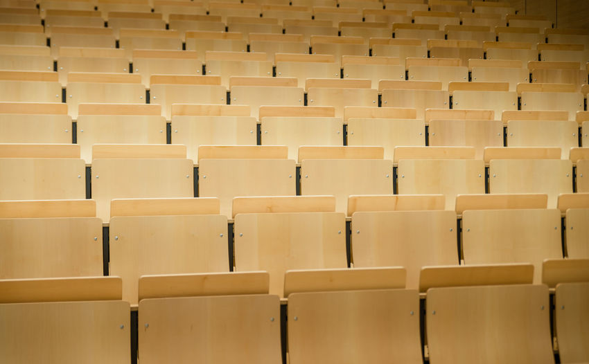 auditorium at a university Arts Culture And Entertainment Auditorium Backgrounds Chair Day Education Full Frame In A Row Indoors  Large Group Of Objects Lecture Hall No People Seat University