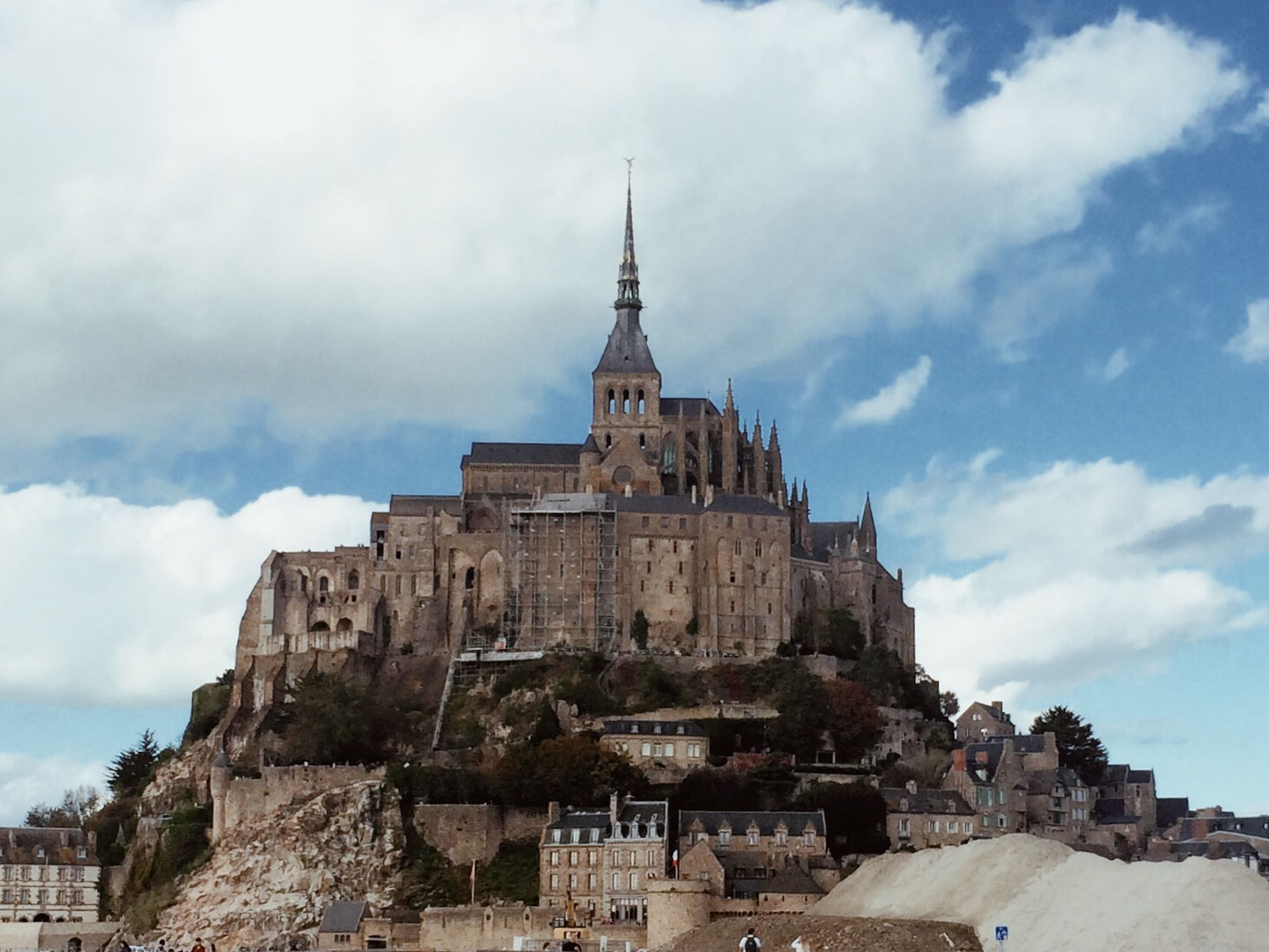 architecture, building exterior, built structure, sky, history, cloud - sky, old, the past, low angle view, old ruin, ancient, cloud, place of worship, cloudy, religion, travel destinations, spirituality, day, castle, famous place