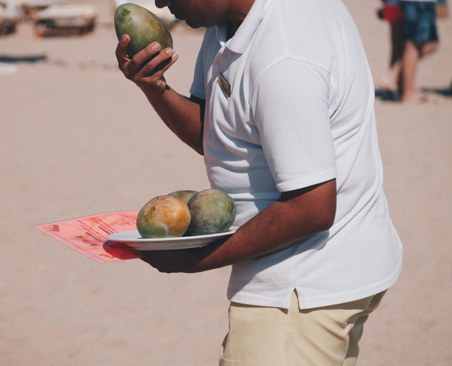 Mango seller Egypt Mango Tree Apple - Fruit Beach Close-up Day Food Food And Drink Fruit Healthy Eating Human Hand Lifestyles One Person Outdoors Real People Seller Summer