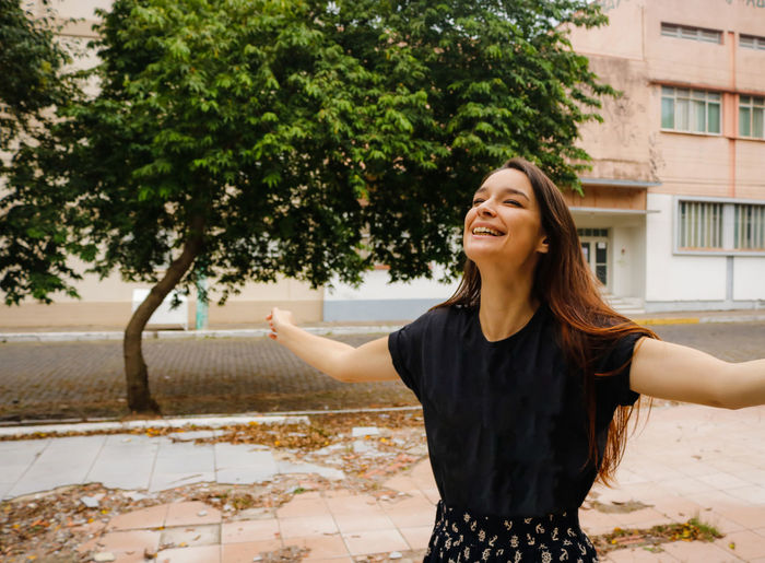 Brazilian Cheerful Day Fun Happiness Happy Lifestyles Nature One Person Outdoors Real People Retro Smiling Standing Street Thankful Tree Young Adult Young Women