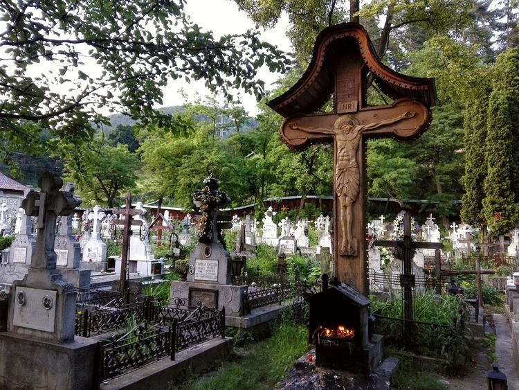 Bistrita cimitery, near Piatra Neamt, Romania, a traditional romanian carved wood cross. Belife Carved Cross Cimetery Day Gazebo God Green Color Growth Jesus Jesus Cross Lush Foliage Nature No People Old Cimetery Outdoors Plant Religion Romanian Cimetery Sky Temple - Building Tranquility Tree Wood Cross