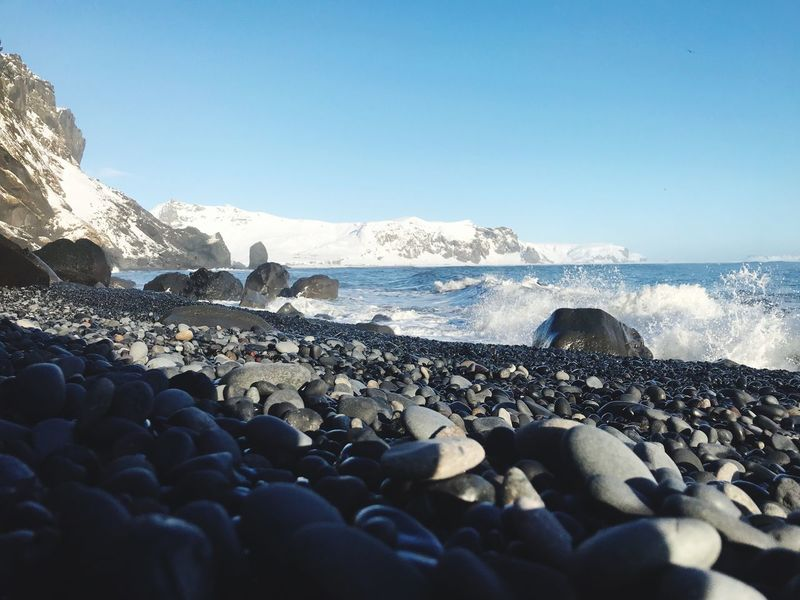 Iceland in the morning Winter Cold Snow Iceland Beauty In Nature Pebble Beach Nature Clear Sky Mobility In Mega Cities Outdoors Blue Pebble Beach No People Sky Scenics Wave