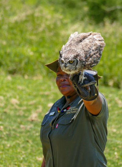 The birds in this collection are all in the African Bird of Prey Sanctuary. They are all rescued birds who are not able to survive in the wild. Adult Bird Bird Handler Bird Of Prey Bird Sanctuary Camouflage Clothing Day Horned Owl Outdoors Raptor