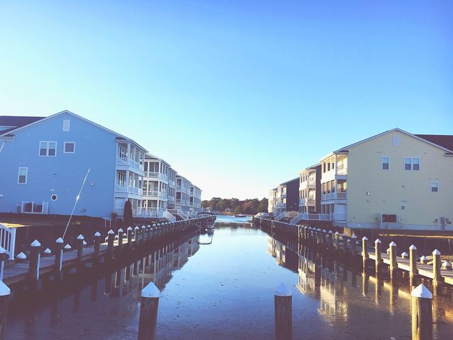 Symmetry Water Built Structure Building Exterior Architecture Clear Sky Reflection Blue Outdoors Nature No People Day Sky Pastel Waterfront Waterfrontview Waterfront♥