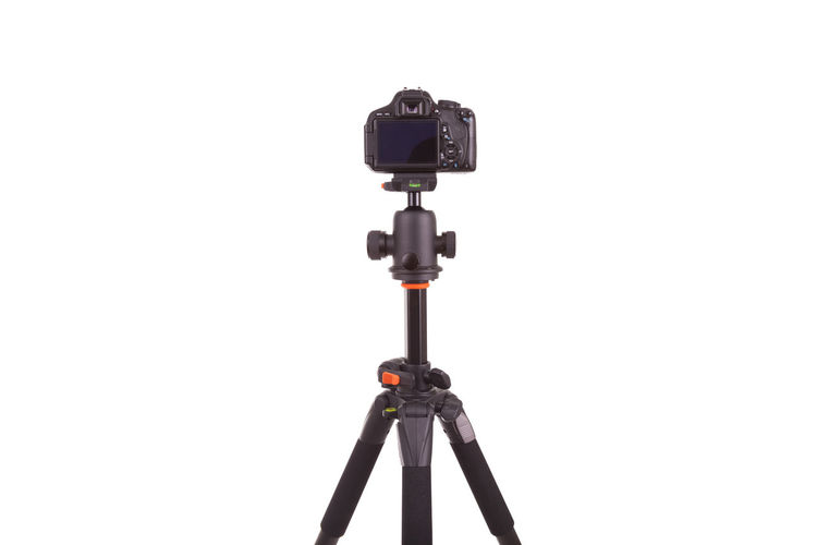Low angle view of camera against white background