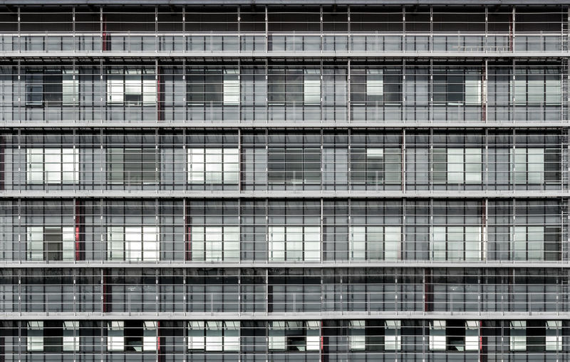 Geometrically correct architectural background of modern office building facade Abstract Apartments Architectural Building Cage City Construction Exterior Facades Front View Geometry Gray High Modern Office Pattern Sad Seamless Shapes Structure Texture Urban Wall Windows London Lifestyle