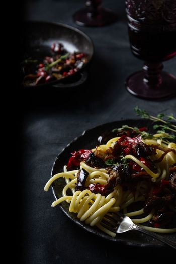 Close-up Dark And Moody Dark Food Photography Dinner Food Food And Drink Freshness Garnish Glass Healthy Eating Herb High Angle View Indoors  Indulgence Italian Food Meal No People Pasta Plate Ready-to-eat Serving Size Spaghetti Still Life Table Wellbeing