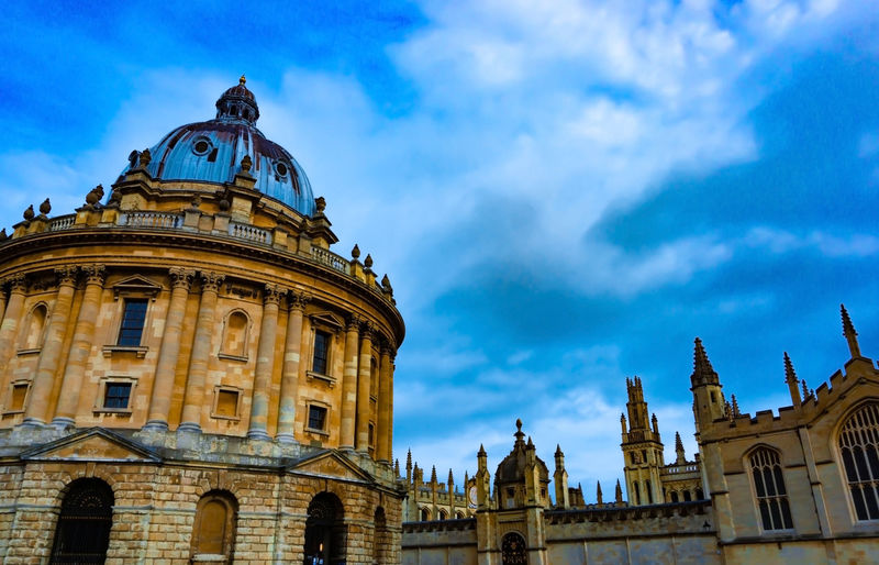 Radcliffe Camera, Library in Oxford University, United Kingdom in cloudy day Building Exterior Architecture Sky Built Structure Cloud - Sky Low Angle View Travel Destinations Nature History The Past Travel Tourism Building Dome No People Spirituality City Religion Day Belief Government Outdoors Oxford England University United Kingdom Radcliffe Camera Library Campus Blue