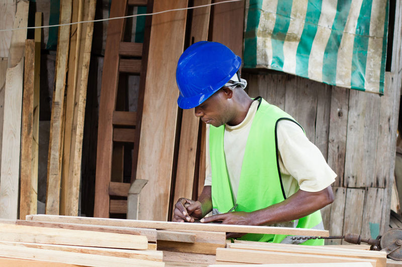 The carpenter planed wood before making furniture.