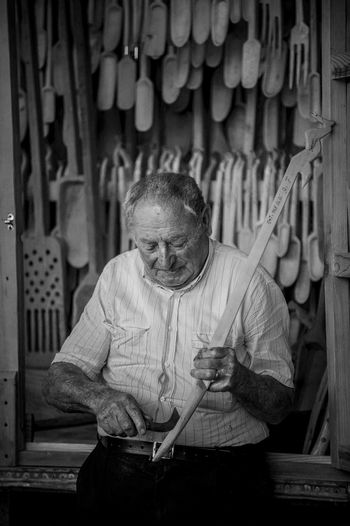 Senior man with work tools in workshop