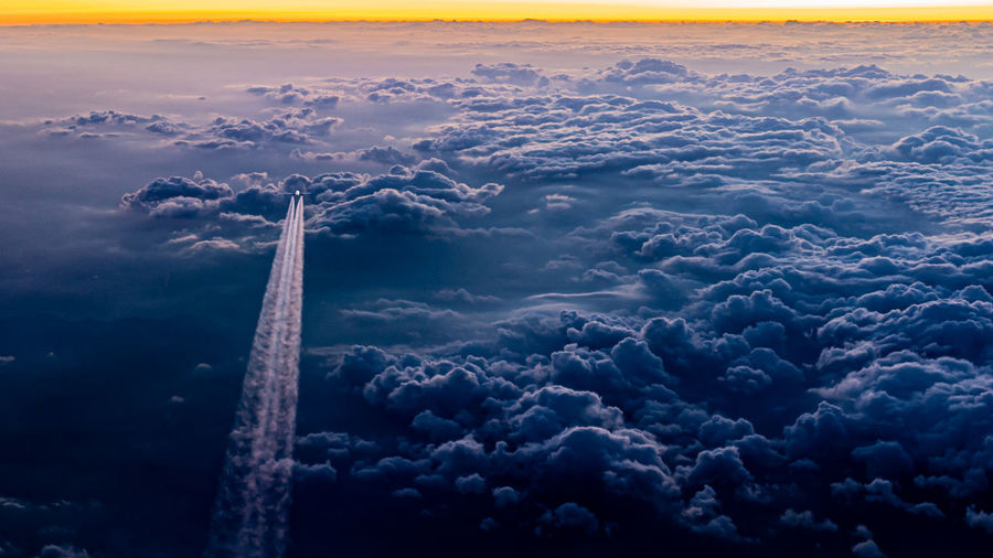 High angle view of airplane flying in sky