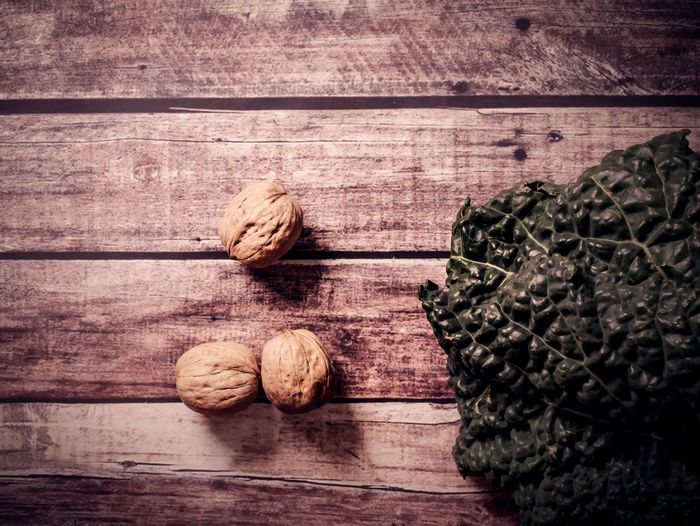 Wood - Material Table Still Life Food And Drink Food Indoors  No People Wellbeing Freshness Healthy Eating Nut Close-up Walnut Nut - Food Brown Textured  Vegetable Group Of Objects Raw Food Pattern Wood Grain Black Cabbage