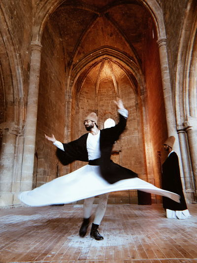 Dervishes dancing in former Christian church in Turkish Nicosia Architecture Photography Dervish Dance Nicosia, Cyprus Spinning Around Full Length Dancing Dancer Architecture Hand Raised Human Arm Live Event Arms Outstretched Arms Raised Concert Dance Music Historic Archway